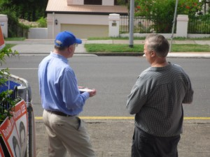 """Phil"" talking to Senator George Brandis (left, in the LNP hat)"