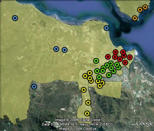 "Polling booths in Herbert. ""Townsville"" in red, ""Mundingburra"" in green, ""Thuringowa"" in yellow, ""Rural"" in blue, ""Islands"" in orange. Palm Island not shownn."